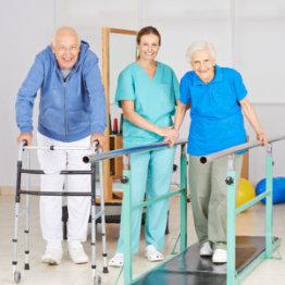 senior woman and her caregiver preparing food