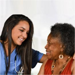 senior woman having a tea with her caregiver