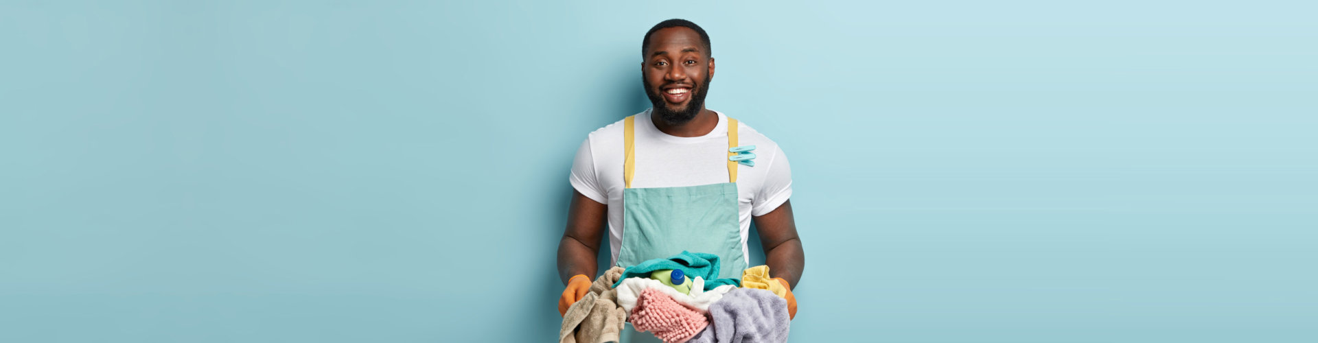 caregiver holding a basket of dirty clothes