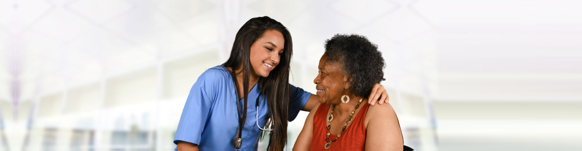adult woman and caregiver looking at each other